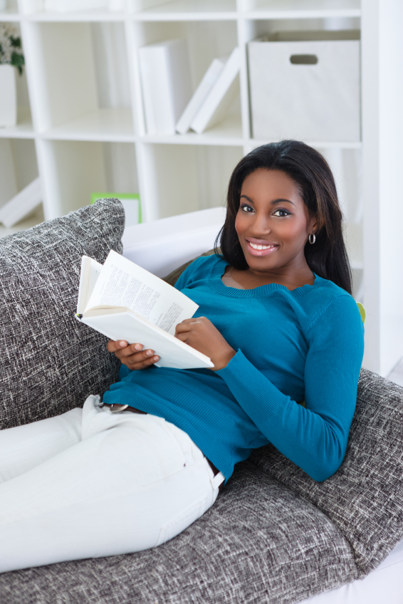 Image result for image of woman sitting comfortably on a sofa